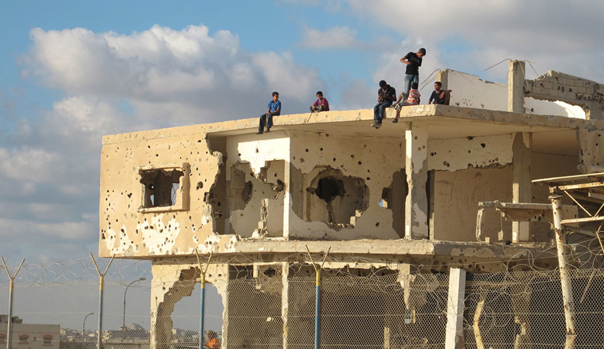 A group of youngsters sit on an abandoned building in Gaza. UN Photo/Shareef Sarhan