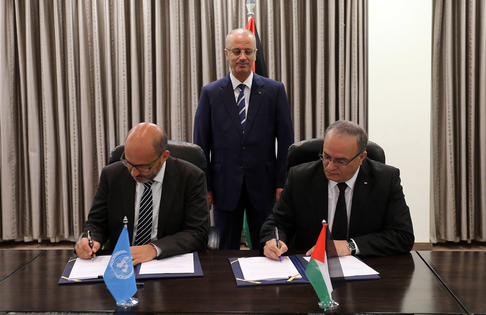 United Nations Coordinator for Humanitarian Aid and Development Activities in the Occupied Palestinian Territory, Mr. Robert Piper, and Palestinian Minister of Social Development, Dr. Ibrahim Al Shaer, sign new development strategy (UNDAF) for 2018-2022 in Ramallah